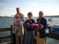 Commodore Allan Jarvis, Rev. Kitty Babson, and Marty Jarvis who threw wreath overboard following the